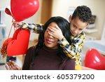 african american boy holding... | Shutterstock . vector #605379200