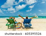 couple on the beach at tropical ... | Shutterstock . vector #605395526