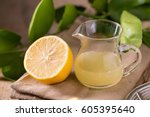glass bowl of freshly squeezed... | Shutterstock . vector #605395640