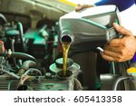 car mechanic replacing and... | Shutterstock . vector #605413358