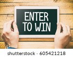 enter to win   hands holding... | Shutterstock . vector #605421218