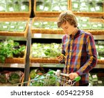 young man buying vegetables at...   Shutterstock . vector #605422958