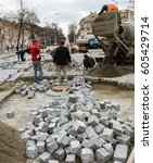Small photo of ODESSA, UKRAINE -20 March 2017: Repair of iron tram line. Installation railway rails trams. Laying stone pavers, road paving slabs on street. Repair and reconstruction of urban highways with tram line