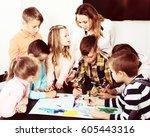portrait cheerful team of...   Shutterstock . vector #605443316