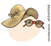fashionable straw hat with wide ...   Shutterstock .eps vector #605445068