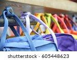 colorful knapsack hang on bar   ... | Shutterstock . vector #605448623