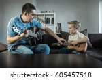 father teaching his son to play ... | Shutterstock . vector #605457518