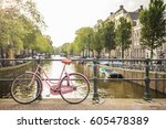 pink bicycle on a bridge among...   Shutterstock . vector #605478389