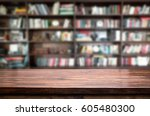 empty wooden table and modern... | Shutterstock . vector #605480300
