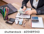 woman filling 1040 individual... | Shutterstock . vector #605489543