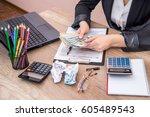 woman filling 1040 individual... | Shutterstock . vector #605489543