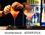 barmen is making cocktails | Shutterstock . vector #605491916
