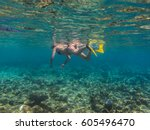 young woman with yellow fins... | Shutterstock . vector #605496470