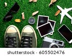 sneakers with old camera and... | Shutterstock . vector #605502476