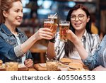happy friends touching their...   Shutterstock . vector #605506553