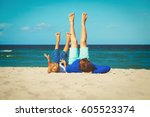 father and little son play on... | Shutterstock . vector #605523374