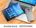 laptop  smartphone  pad on... | Shutterstock . vector #605524460