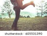 legs of men with women jumping... | Shutterstock . vector #605531390