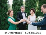 newlyweds and friends clang... | Shutterstock . vector #605551088