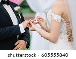 bride wears a ring on the hand... | Shutterstock . vector #605555840