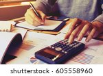 young man using calculator and... | Shutterstock . vector #605558960
