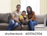 smiling family with son and pug ... | Shutterstock . vector #605562506