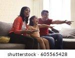 excited family pointing at...   Shutterstock . vector #605565428