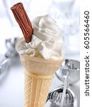 vanilla ice cream cone with... | Shutterstock . vector #605566460