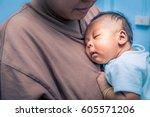 newborn baby boy sleeping on... | Shutterstock . vector #605571206