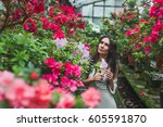 girl in the greenhouse | Shutterstock . vector #605591870