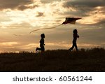 Two Children Enjoy Flying A...