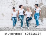 group of four young diverse... | Shutterstock . vector #605616194