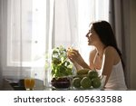 Young Woman Drinking Juice At...