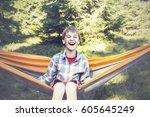 Joyful Boy Is Swinging In A...