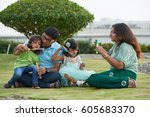 indian family blowing soap... | Shutterstock . vector #605683370
