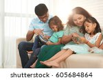 happy indian family using... | Shutterstock . vector #605684864