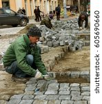 Small photo of ODESSA, UKRAINE-20 March 2017: Repair iron tram line. Installation railway rails for trams. Laying stone pavers, road paving slabs on street. Repair and reconstruction of urban highways with tram line