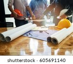 blueprint on desk with... | Shutterstock . vector #605691140