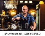 barman at work pouring hard... | Shutterstock . vector #605695460