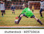 young soccer goalie attempting... | Shutterstock . vector #605710616