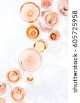 Stock photo many glasses of rose wine at wine tasting concept of rose wine and variety white background top 605725958