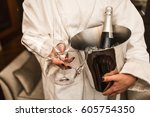 woman is holding bottle of...   Shutterstock . vector #605754350