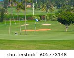 flag on the pin on the green... | Shutterstock . vector #605773148