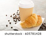 croissants with coffee to go in ... | Shutterstock . vector #605781428