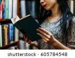 girl young woman in the library ... | Shutterstock . vector #605784548