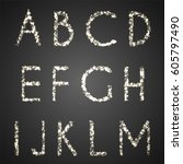 set of glittering uppercase... | Shutterstock .eps vector #605797490