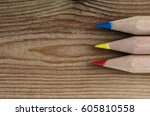 three pencils representing the... | Shutterstock . vector #605810558