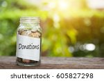 donations word with coin in... | Shutterstock . vector #605827298