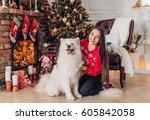 happy girl with samoyed husky...   Shutterstock . vector #605842058