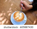 woman's hands holding cup with... | Shutterstock . vector #605887430